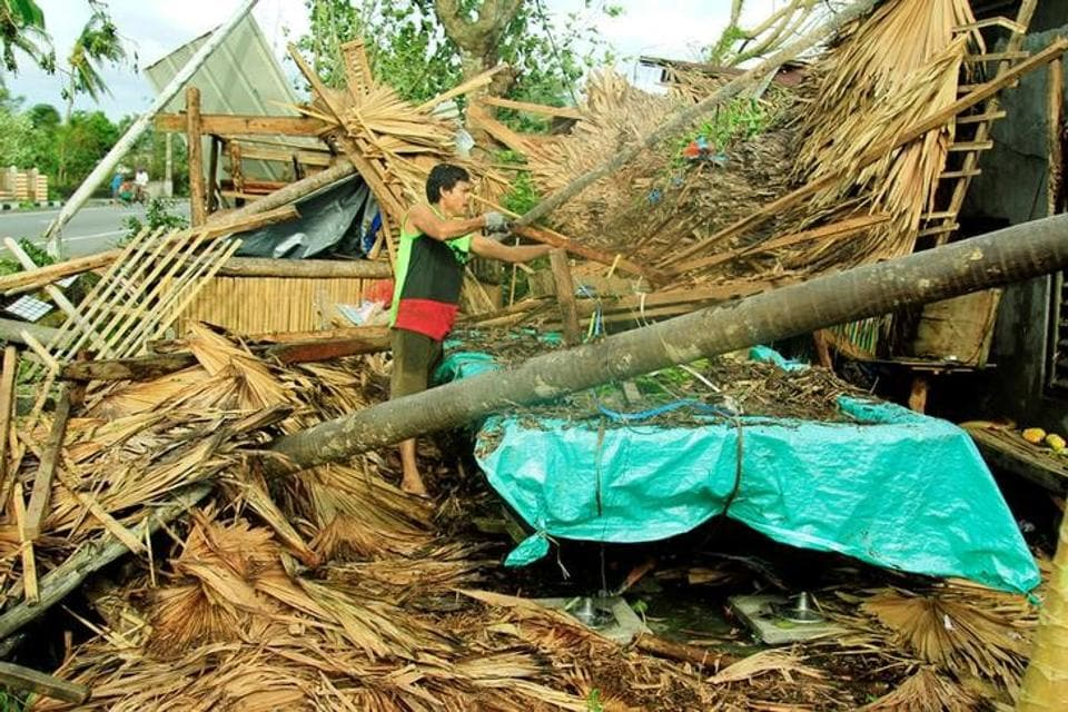 A resident retrieves belongings from his destroyed house after Typhoon Nock-Ten hit Malinao, Albay in central Philippines. (Renellyn Loaquinario/reuters)