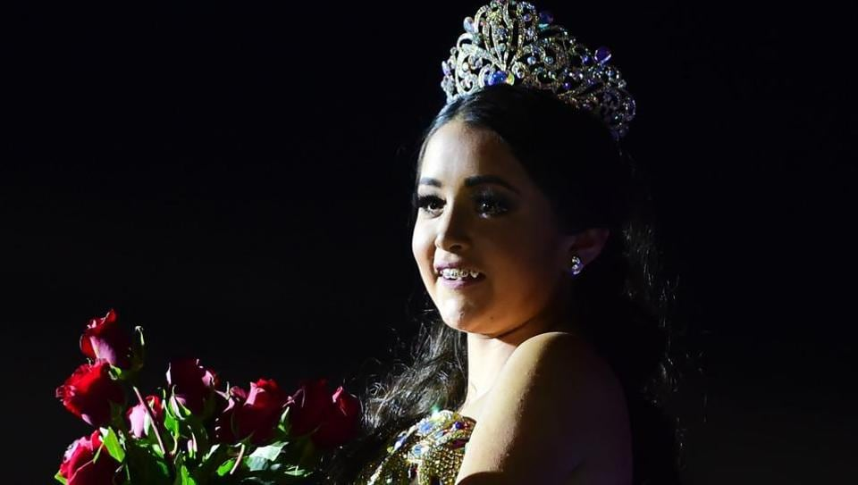 Rubi Ibarra poses during her 15th birthday celebrations in Villa Guadalupe, San Luis Potosi State, on December 26, 2016. Rubi, a small-town Mexican teen, welcomed thousands of guests for her 15th birthday party after her parents' video invitation to the milestone event went viral online.