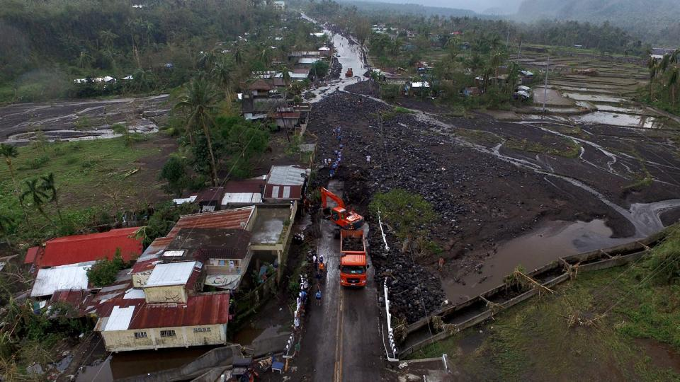 An aerial view shows a road filled with debris in Tabaco.  (Charism Sayat/AFP)