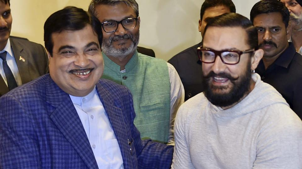 Union minister for Road Transport and Shipping Nitin Gadkari shakes hands with Actor Aamir Khan during the screening of the film 'Dangal' in New Delhi on December 27.