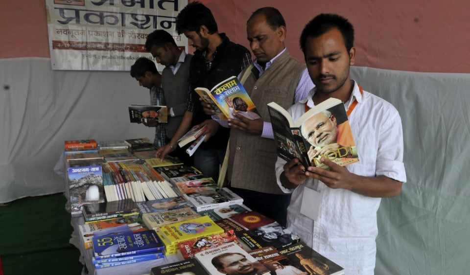 Students go through books at a stall at the ABVP national conference at GACC in Indore on Tuesday.
