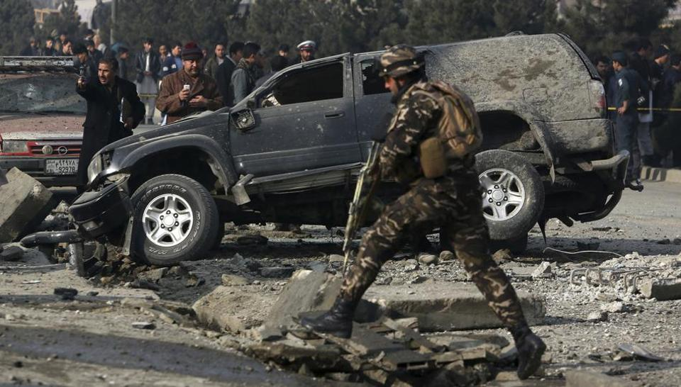 Afghan security personnel inspect at the site of roadside bomb blast in Kabul, Afghanistan. Afghan officials say that at least three people have been wounded by a roadside bomb blast in the capital, Kabul.