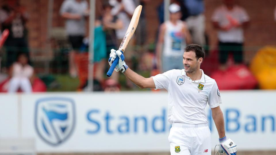 South African batsman Stephen Cook (R) raises his bat as he celebrates after scoring a century against Sri Lanka.
