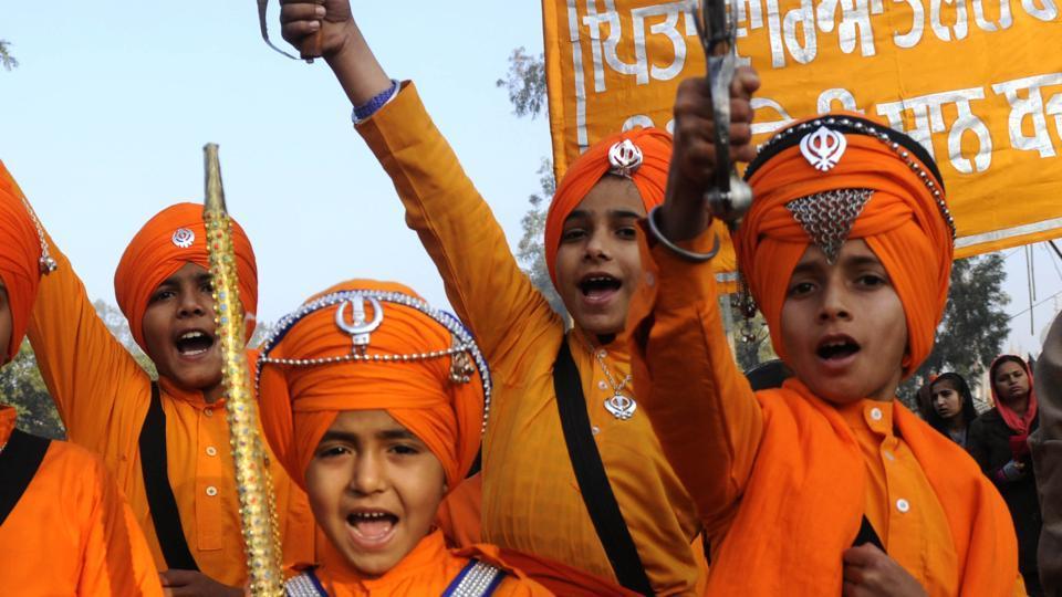 Children in warrior attire during Shaheedi Jor Mela in Fatehgarh Sahib on Tuesday.