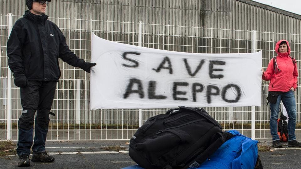 Participants of a solidarity march to Aleppo hold a banner reading 'Save Aleppo' in Berlin,Germany, on December 26, 2016.