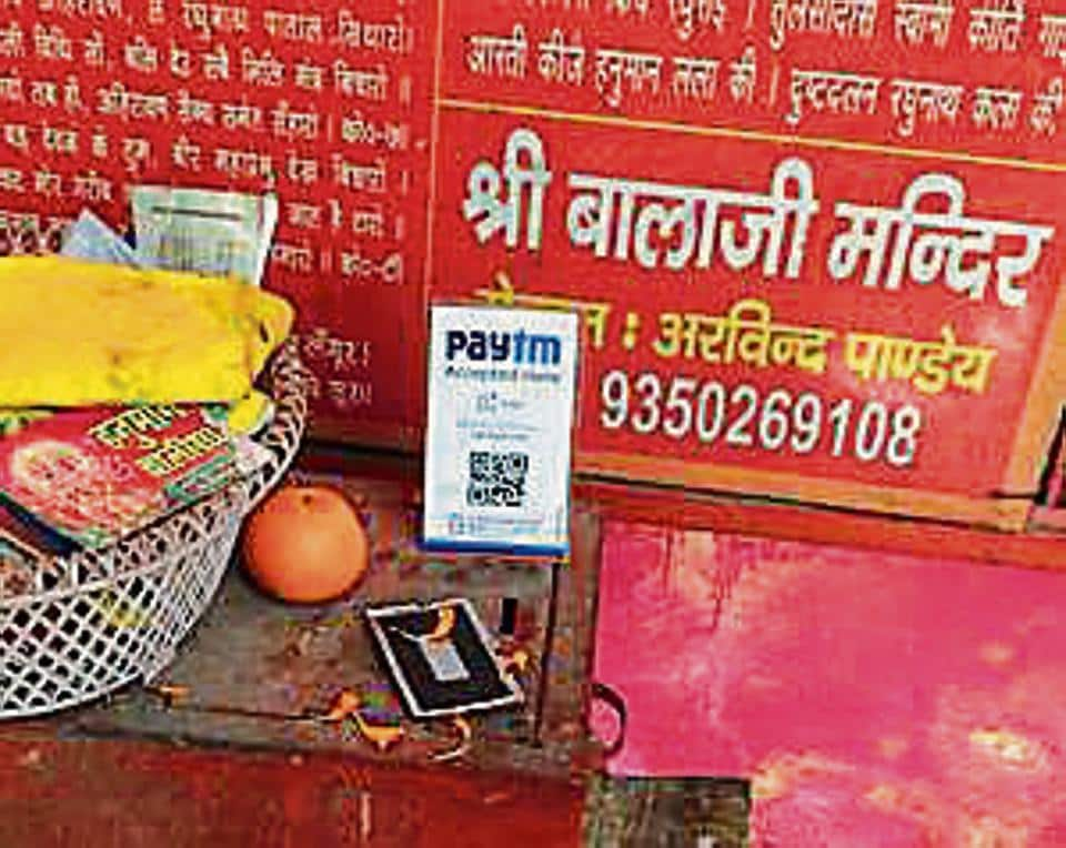 Not being able to collect enough donations due to the cash crisis, temples in Indirapuram have provided the option of e-wallets.