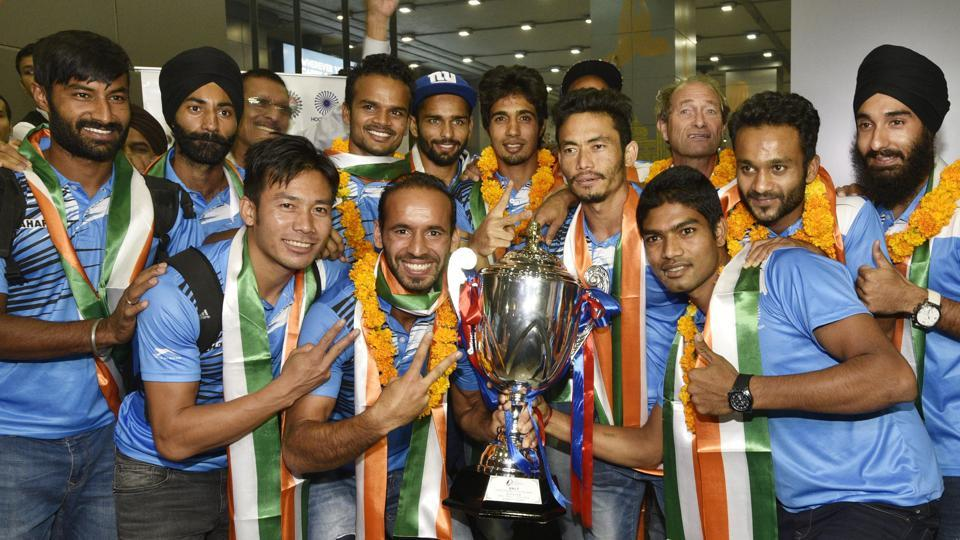 New Delhi, India - Oct. 31, 2016: Indian hockey team poses with Asia Cup trophy after the arriev in T3 Airport, in New Delhi, India, on Monday, October 31, 2016. (Photo by Sanjeev Verma/HT Photo)