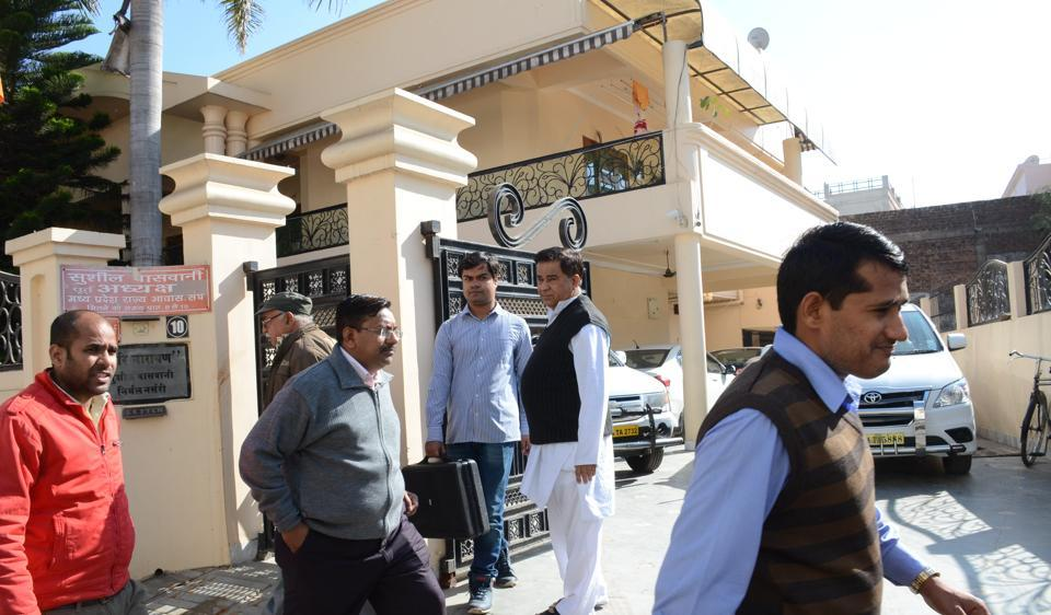I-T officials coming out of the residence of BJP leader Sushil Vaswani at Bairagarh in Bhopal.