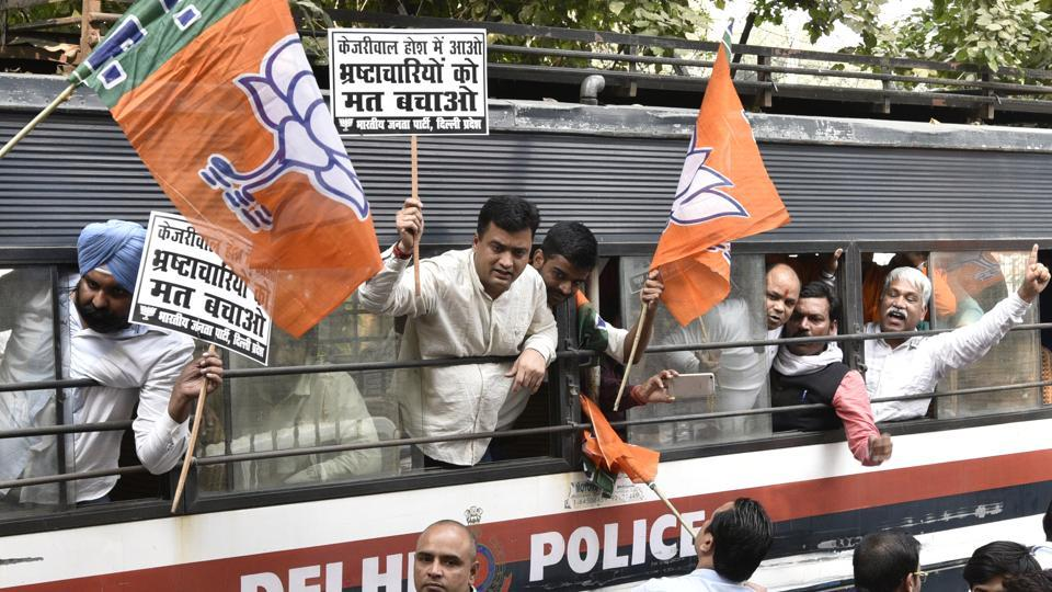 BJP workers being detained as they protest against Delhi CM Arvind Kejriwal during the special session of Vidhan Sabha on black money in New Delhi.