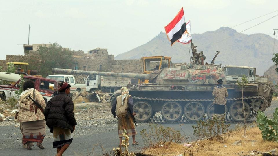 Yemeni fighters loyal to Yemen's exiled president Abedrabbo Mansour Hadi, drive a tank during clashes with Shia Houthi rebels in the country's third-city of Taez.