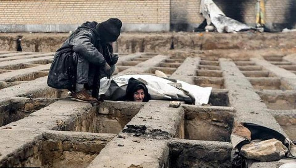 One of the many homeless dwellers in a cemetery in the town of Shahriar, near Iran's capital Tehran.