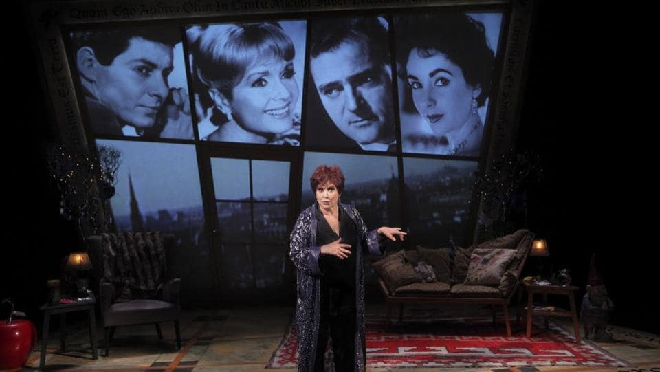 "Carrie Fisher on stage in her autobiographical show ""Wishful Drinking,"" at Studio 54 in New York, Sept. 24, 2009. Pictured from left: her parents Eddie Fisher and Debbie Reynolds, Mike Todd and Elizabeth Taylor. Carrie Fisher, who used her perch among Hollywood royalty to offer wry commentary on the absurdities of fame, died on Dec. 27, 2016. She was 60.  (Sara Krulwich/NYT File Photo)"