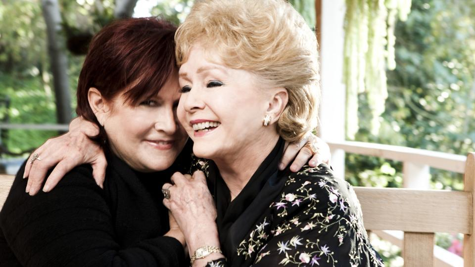 """Carrie Fisher and her mother, Debbie Reynolds, at Fisher's home in Beverly Hills, California on November 27, 2010. Reynolds, the wholesome movie ingénue in 1950s films like """"Singin' in the Rain,"""" """"Tammy and the Bachelor"""" and """"The Tender Trap"""" and one-third of mid-20th-century Hollywood's most scandalous romantic triangle, died Wednesday, a day after the death of her daughter, the actress Carrie Fisher, according to The Associated Press. She was 84. (Kevin Scanton/NYT File Photo)"""