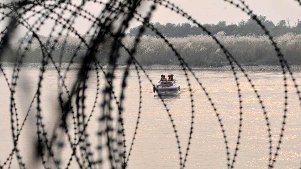 Indian Border Security Force (BSF) soldiers patrol on a boat in Out Post (OP) Chenab along the Pargwal area of India-Pakistan international border in Akhnoor about 70 km from Jammu.