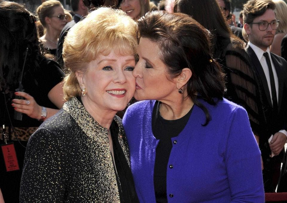 Debbie Reynolds, left, and Carrie Fisher arrive at the Primetime Creative Arts Emmy Awards in Los Angeles.
