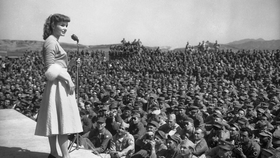 In this May 22, 1955, file photo, actress Debbie Reynolds entertains at 8th Army headquarters in Seoul, South Korea.  (AP File Photo)