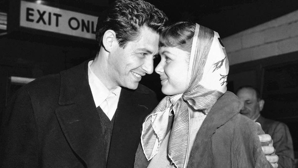 In this April 19, 1955, file photo, singer Eddie Fisher and his fiancee, actress Debbie Reynolds, look at each other at Idlewild Airport in New York.  (AP File Photo)