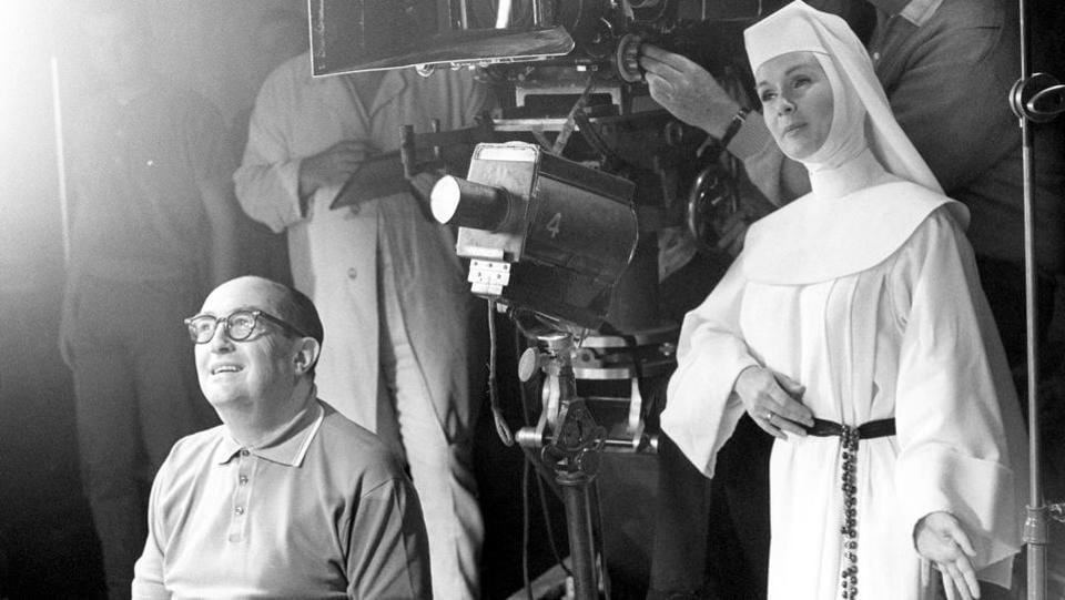 In this November 15, 1965, file photo, Debbie Reynolds, dressed as nun for her role as a singing nun in the MGM picture of that name, practices her next scene while she watches a scene being filmed.  (AP FILE PHOTO)