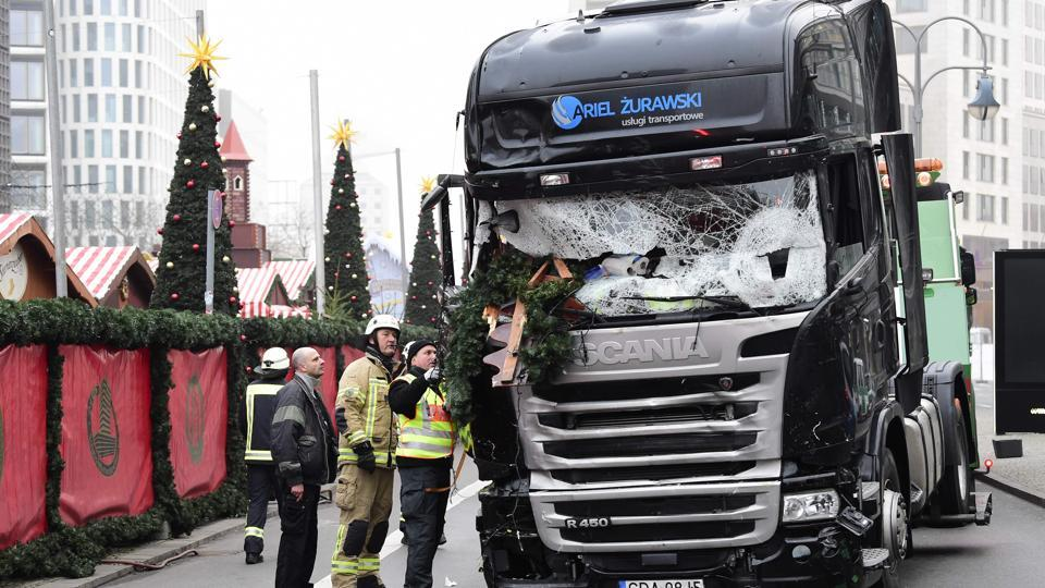 Firemen inspecting the truck that crashed into a Christmas market at Gedächtniskirche church in Berlin on December 19.