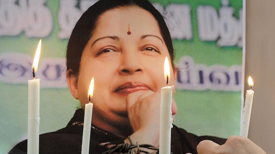 A supporter of J Jayalalithaa lights candles while pay tribute after her death.