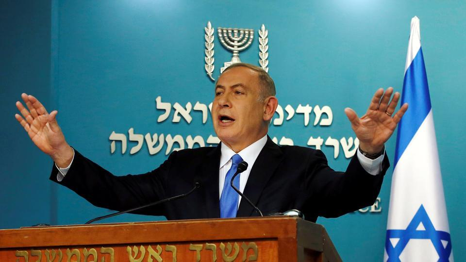Israeli Prime Minister Benjamin Netanyahu delivers a speech in his Jerusalem office.