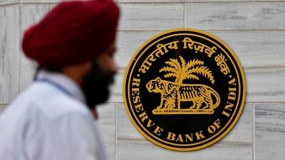 A person walks past the Reserve Bank of India head office in Mumbai.