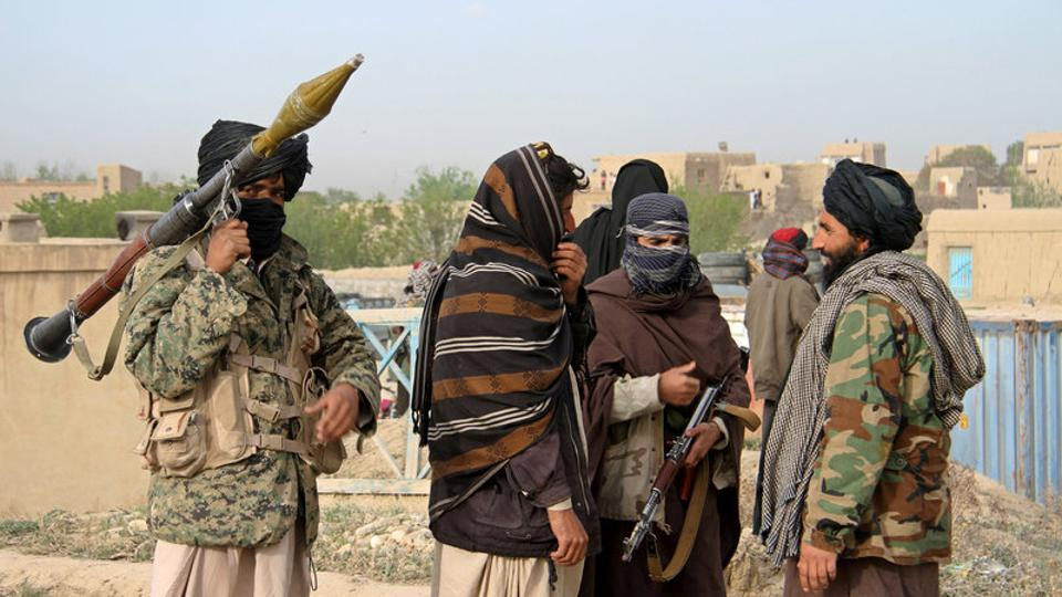 File photo of members of the Taliban at the site of the execution of three men accused of murdering a couple in Ghazni province, Afghanistan in April 2015.