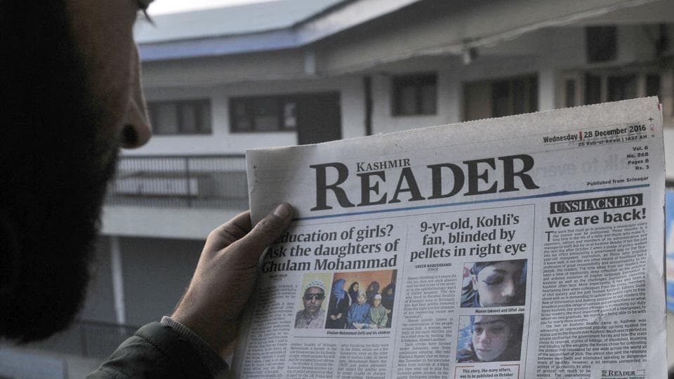 A  man reading Srinagar-based English newspaper Kashmir Reader, which hit news stands on Wednesday after the government lifted about three months ban on the newspaper.