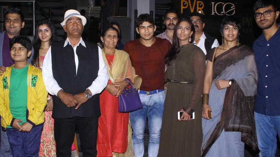 Wrestlers Mahavir Singh Phogat, Geeta Phogat and Babita Kumari along with their family during the screening of film Dangal in Mumbai on Dec 22, 2016.