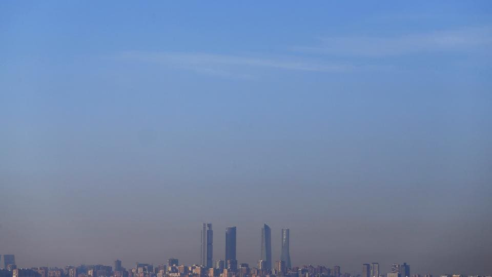 A layer of smog covers the four towers which mark Madrid's skyline in Spain.