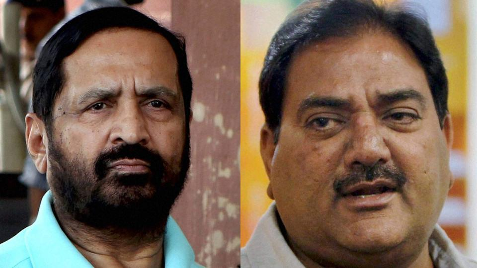 Suresh Kalmadi (R)and Abhay Chautala were named as Indian Olympic Association life-president on Tuesday.