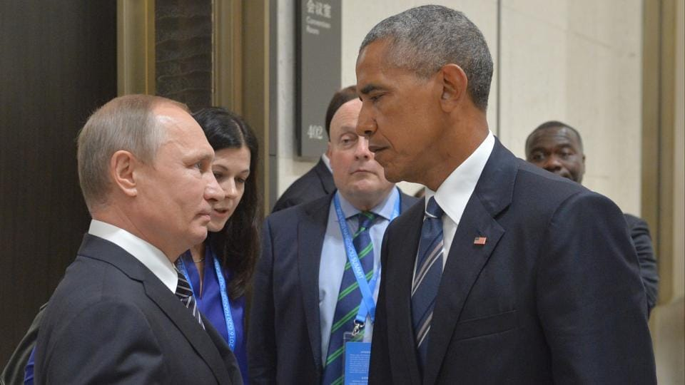 In this Sept. 5, 2016 file photo, Russian President Vladimir Putin, left, speaks with U.S. President Barack Obama in Hangzhou in eastern China's Zhejiang province.