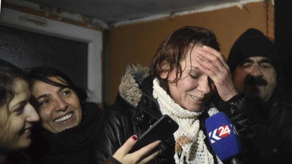 Turkish novelist Asli Erdogan, who was arrested in August, speaks to the media after her release from Silivri prison outside Istanbul, late Thursday, Dec. 29, 2016. Erdogan is accused of membership in the outlawed Kurdistan Workers' Party, or PKK, of threatening Turkey's unity and engaging in terrorist propaganda.
