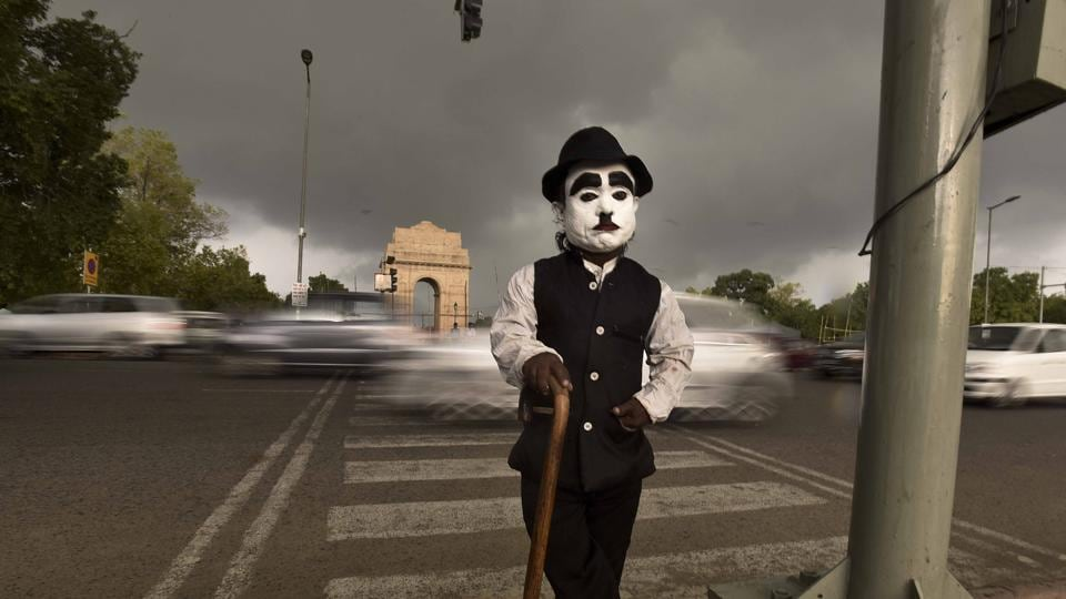 Monu, 52, is a tourist attraction in the lawns of India Gate. He is less than three feet and makes a living by posing as Charlie Chaplin. He charges Rs 10-Rs 20 for every selfie shot with him by tourists but sometimes people mock him and call him names.