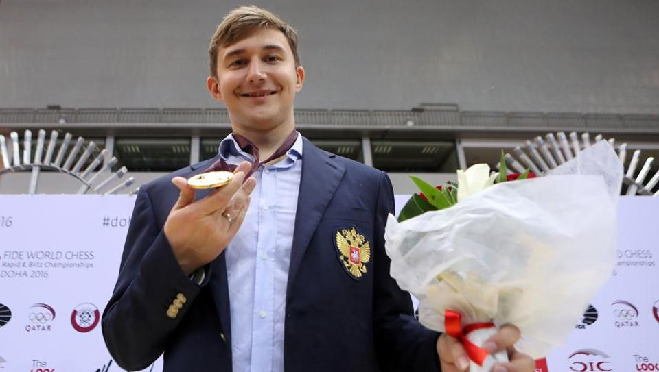 Russian grandmaster Sergey Karjakin celebrates after winning a gold medal in FIDE World Chess Rapid & Blitz Championships 2016.
