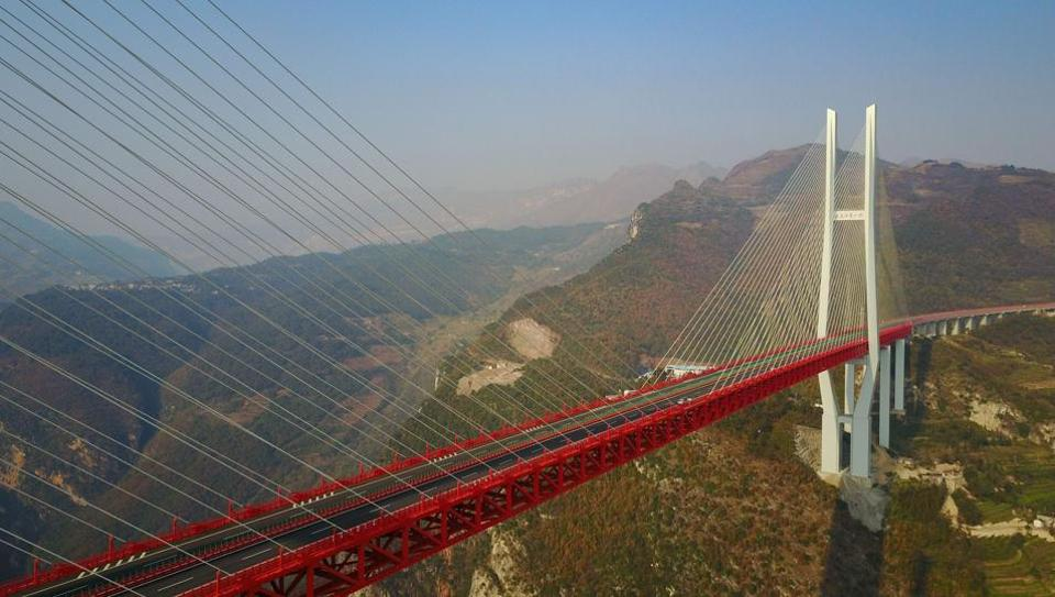This picture taken on December 28, 2016 shows the Beipanjiang Bridge, near Bijie in southwest China's Guizhou province. The world's highest bridge has opened to traffic in China, connecting two southwestern provinces and reducing travel time by three quarters, local authorities said on December 30.