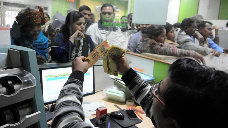 People deposit their old notes at Oriental Bank of Commerce in Sector 14  on Friday.