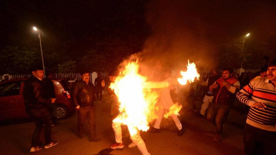 A Samajwadi Party supporter tries self-immolation outside CMAkhilesh Yadav's residence in Lucknow on Friday.