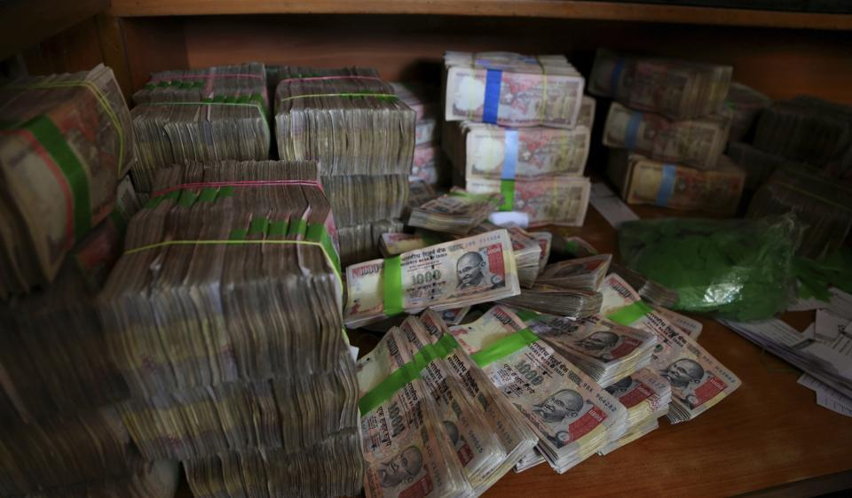 Discontinued Indian currency notes of Rs 1,000 seen after they were deposited by people at a bank in Bangalore.