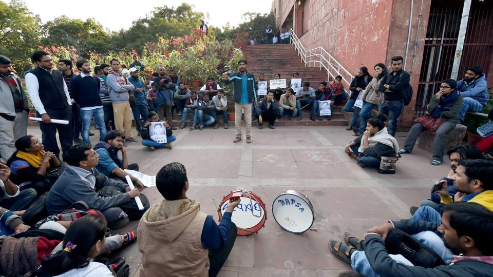 JNU students protest at the administration block in JNU Campus on the suspension of eight students in New Delhi on Wednesday.