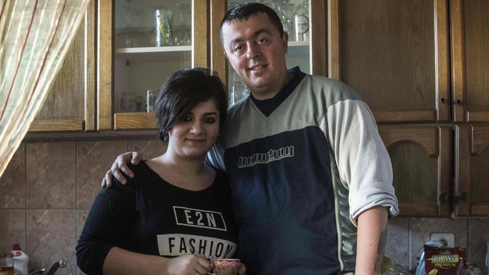 Noora Arkavazi (L) and her husband Bobi Dodevski at their home in Kumanovo.
