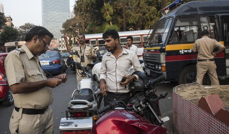 Officials stop vehicles at Dadar during a nakabandi on Friday, as part of the police's security arrangements ahead of New Year's Eve in Mumbai.