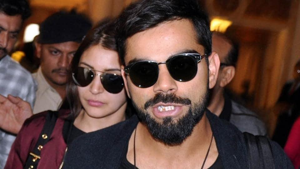 Indian test captain Virat Kohli with actor Anushka Sharma arrive at a hotel in Rajkot in November.