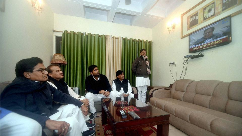Samajwadi Party general secretary Ram Gopal Yadav watching the TV in Lucknow on Friday. Yadav was expelled from the party for six years.
