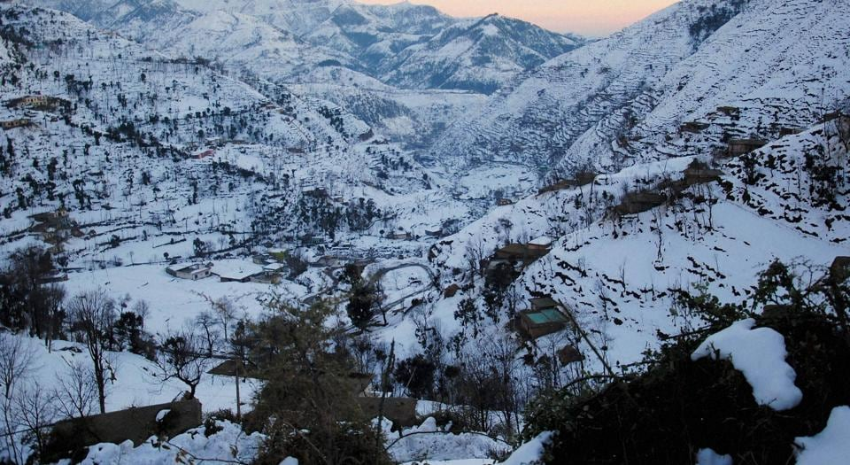 A view of snow-covered upper reaches of Peer Panchal Range as pictured from Poonch in Jammu and Kashmir.