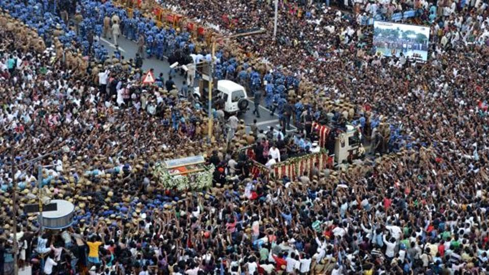 Crowds surround the funeral procession of Tamil Nadu's former Chief Minister J Jayalalithaa in Chennai.