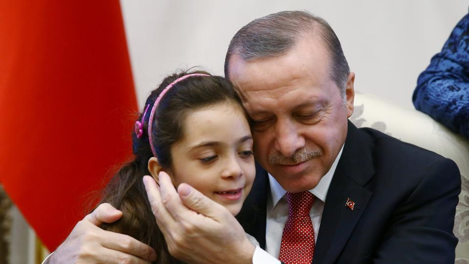 Turkish President Tayyip Erdogan meets with Syrian girl Bana Alabed, known as Aleppo's tweeting girl, at the Presidential Palace in Ankara. Turkey's main interest in the ceasefire in Syria appears to be able to turn its guns on the Kurds.