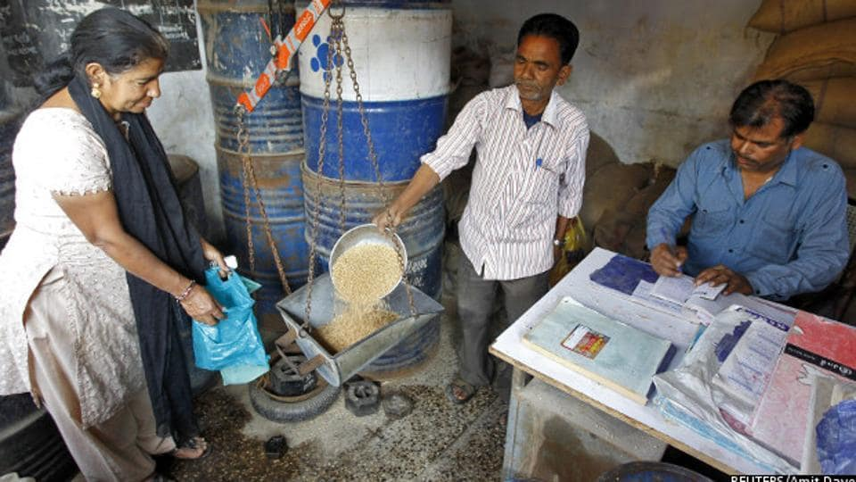 A woman buys wheat from a government-run ration shop in Ahmedabad, Gujarat. The government has identified over 23 million ineligible ration cards between 2013 and 2016, and 32.1% of the fair price shops have been automated under the end-to-end computerisation of targeted public distribution system, thereby checking subsidy leaks.