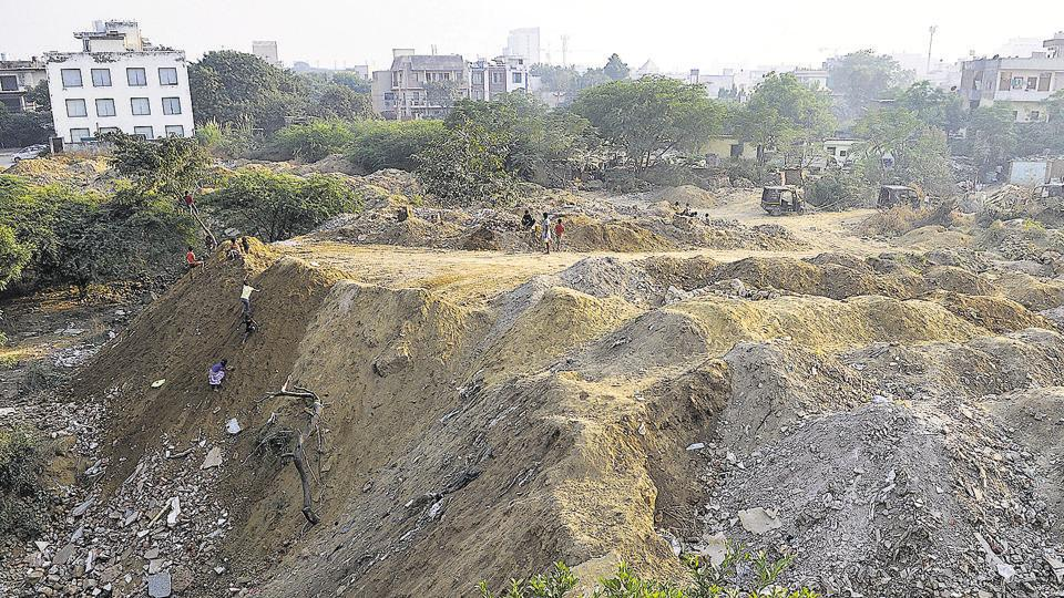 A seasonal water body in DLF phase 3 was continuously filled with construction waste last year. Similar incidents were reported from different parts of the city and the first construction and demolition waste plant to be set up by the MCG is aimed at mitigating the issue.