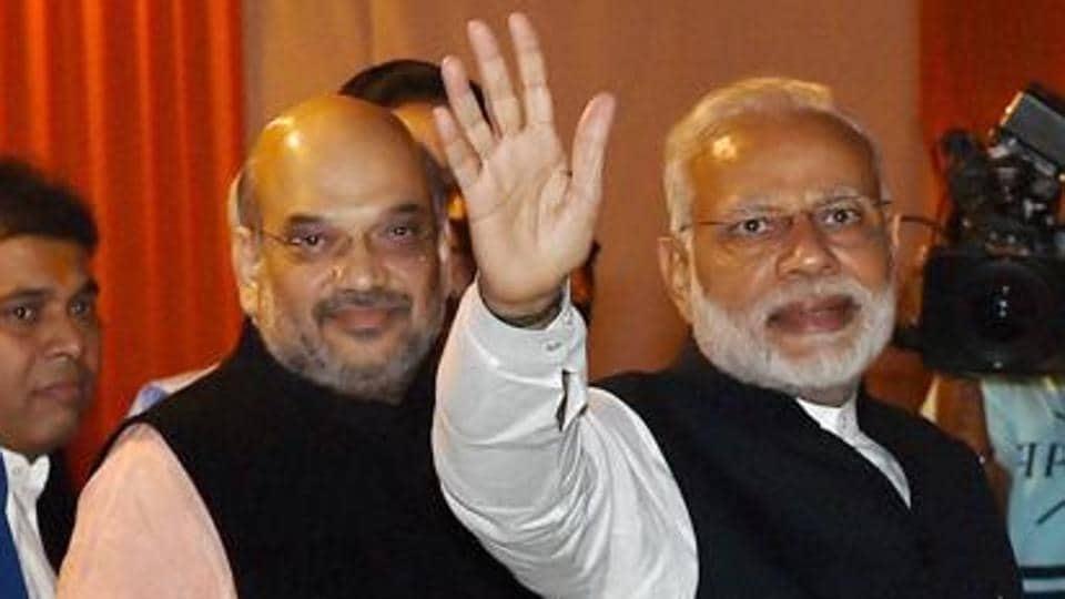 Prime Minister Narendra Modi (right) with BJP president Amit Shah at the party headquarters in New Delhi in November 2016.